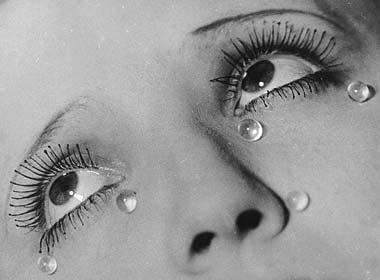 Man Ray photo of eyelash beading